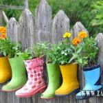 1308188518_rainboot-garden-on-a-fence-500x319