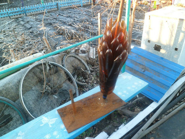 Фото основания для пальмы из бутылок